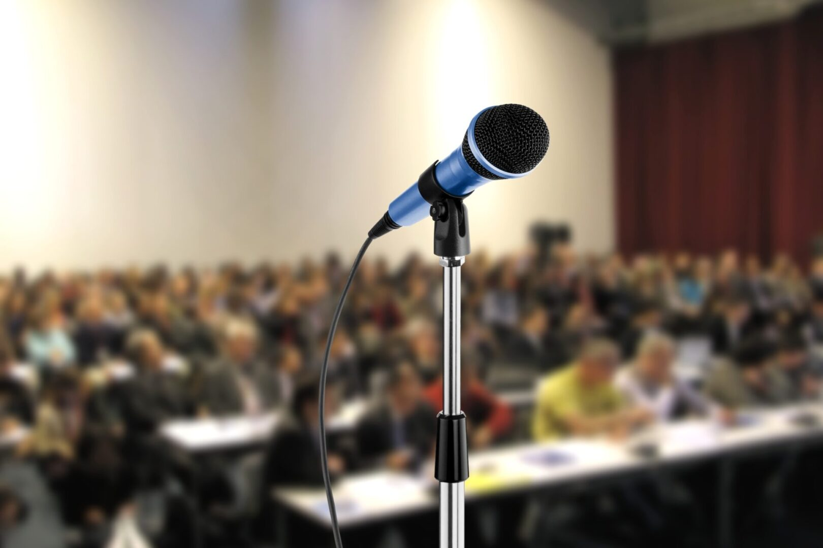 Image of microphone during seminar in a hall